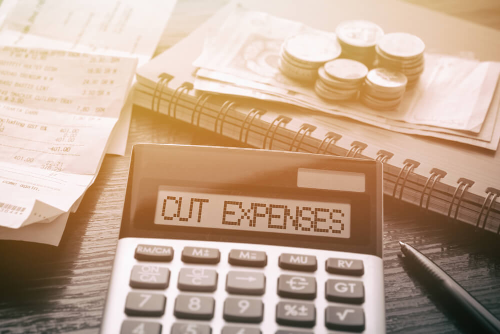 business expenses cut half