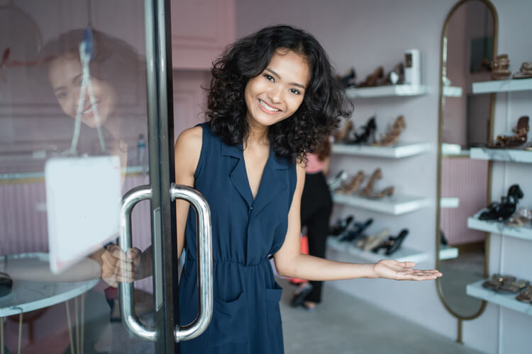 merchant cash advance all credit shoe store owner welcoming