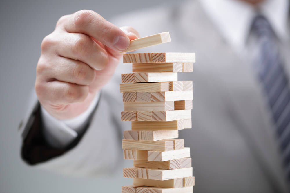 Business man stacking building blocks