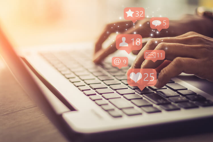 social media small business hands at keyboard