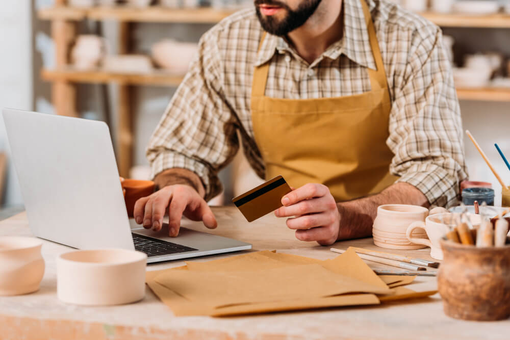 Small business owner using a credit card